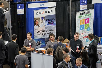 Alumni recruit for Draper at the Career Fair