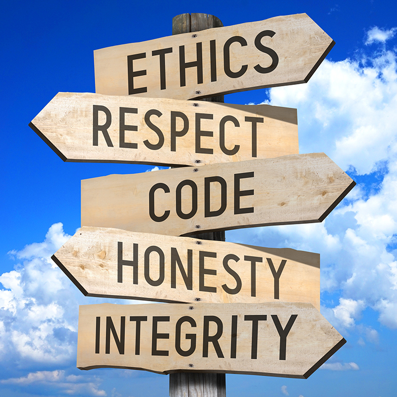 Signpost with ethics, respect, code, honesty and integrity signs on it.