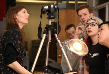 Filmmaker and animator Martha Colburn, left, guides students through making their own experimental film during her visit as Artist-in-Residence for Center for Arts & Ideas.