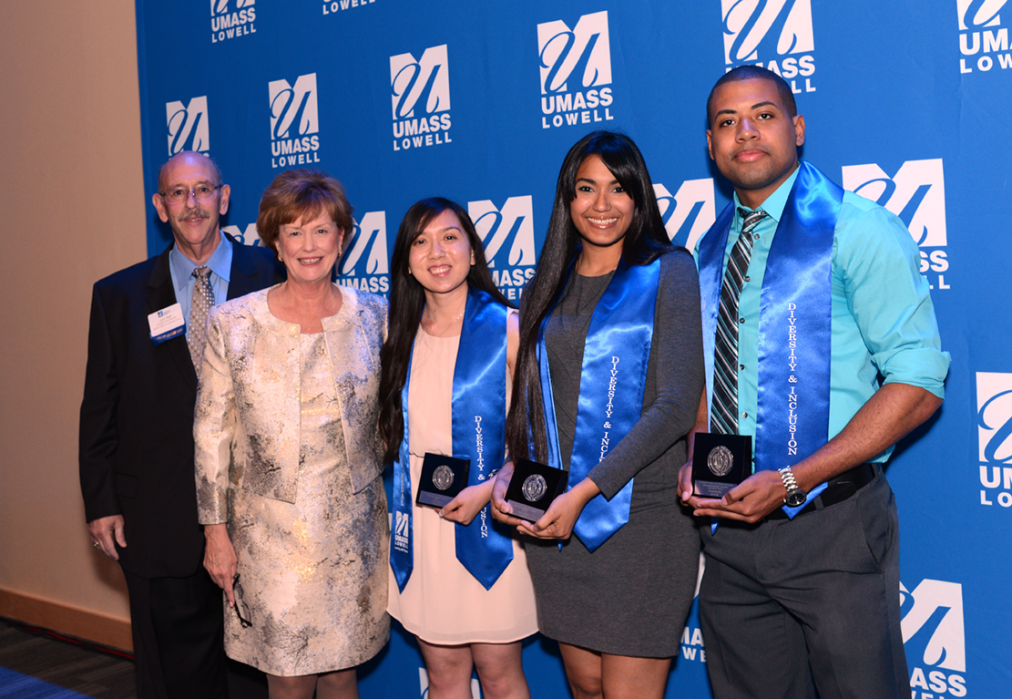 Larry Siegel, Associate Vice Chancellor for Student Affairs and University Events, and Chancellor Jacquie Moloney with three honored student award winners at the 2017 Commencement Eve Celebration