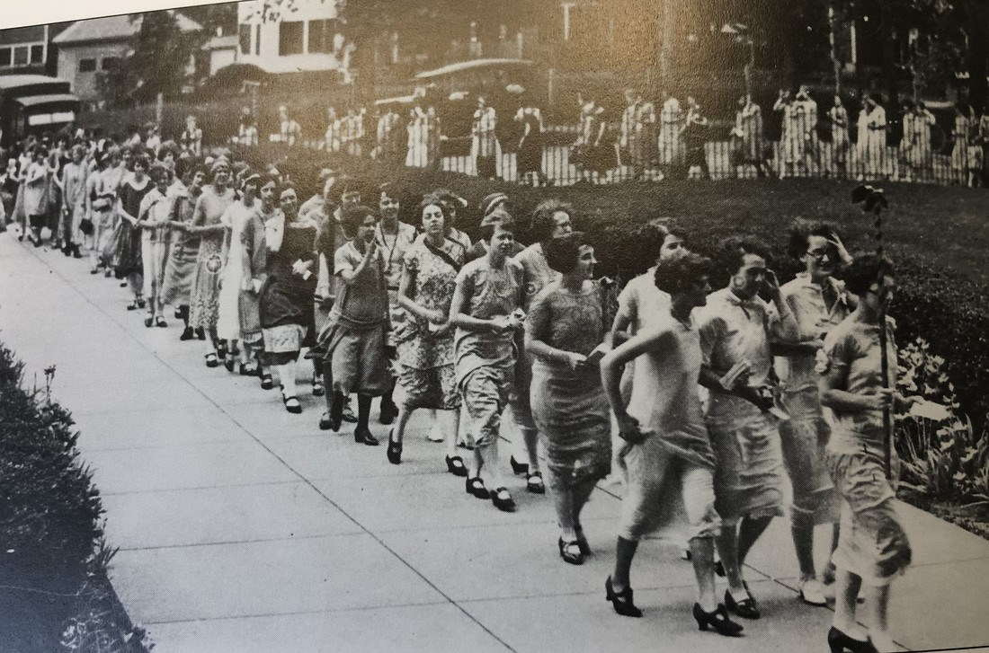 Lowell Normal School students line the sidewalk in 1931 at commencement