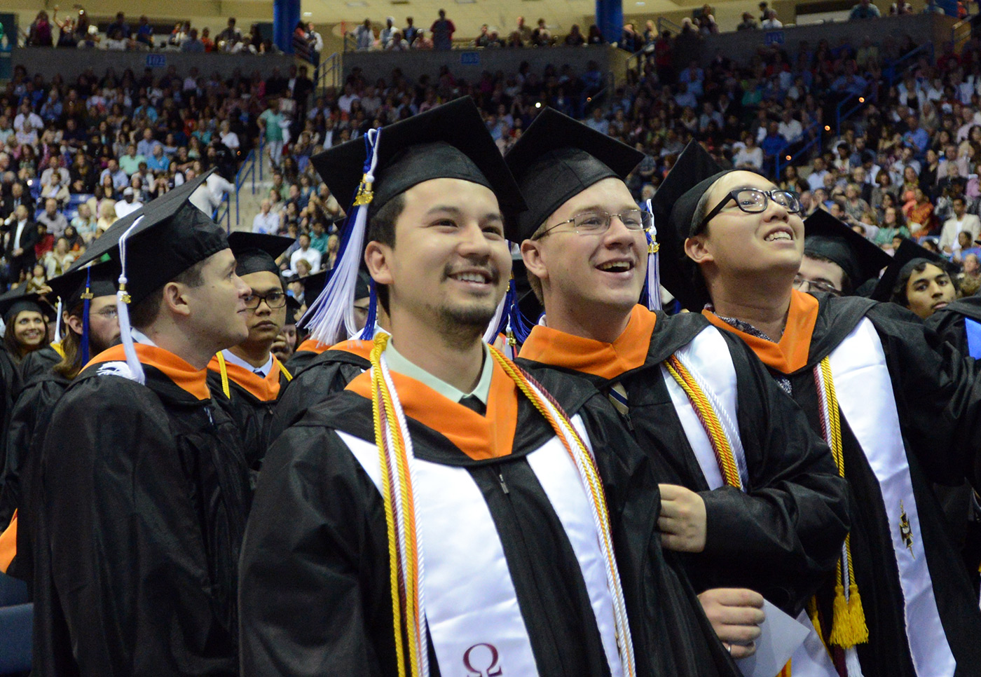 commencement-orange-hoods-males