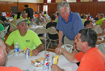 Hundreds of contracted tradespeople were treated to appreciation lunches on North and South campuses recently. Here, workers line up in Cumnock Hall, where the event was moved due to rain.