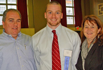 Plastics Engineering major Gregory Pigeon, center, pictured with his parents John and Carol Pigeon of West Bridgewater, was recently honored with an Outstanding Co-op Achievement Award.
