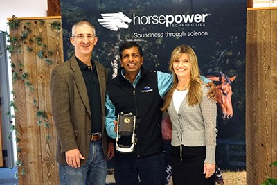 from left, Tom O'Donnell, director of UML's iHub, Mouli Ramani, president and CEO of Horsepower Technologies, and iHub Associate Director Lisa Armstrong, in the entrance to Horsepower Technologies' new office