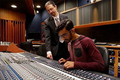 Brandon Vaccaro works with Vivek Patel '18 on the sound board
