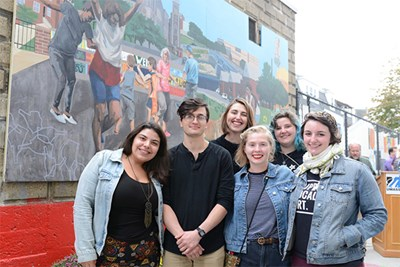 Art and Designs students and alumni painted a mural celebrating the Acre neighborhood, and it is now on display on Decatur WAY