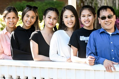 From left, mother Bonna, sisters Brianna, Krissandra, Celena and Alexandra and father Cuong Mai.