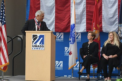 Veteran Marty Martinez thanks Chancellor Jacquie Moloney and Janine Wert