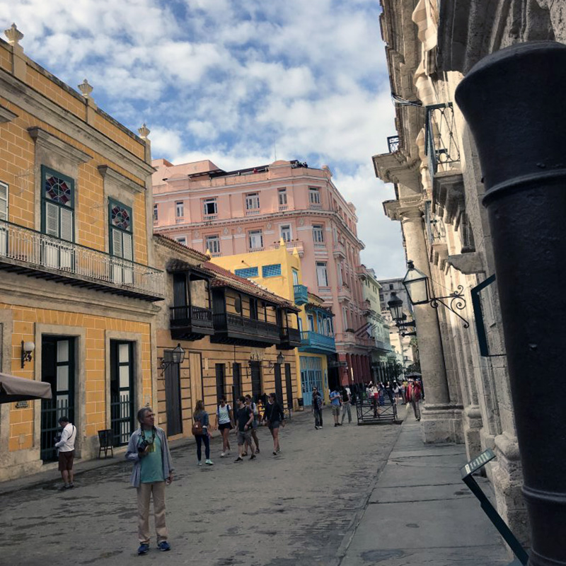 Street view picture from 2017-2018 UMass Lowell Winter Study Abroad trip to Cuba. This traveling seminar will use the Cuban experience as a backdrop for experiential learning, along with discussions with professionals in that particular field of study, and writing assignments designed to allow students to reflect upon their experience studying and living in Cuba. Students will gain a multi-disciplinary overview of Cuban contemporary culture. and further understanding from a cultural, socio-political and historical context.