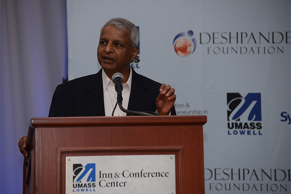 Desh Deshpande addressing the crowd at least year's symposium.