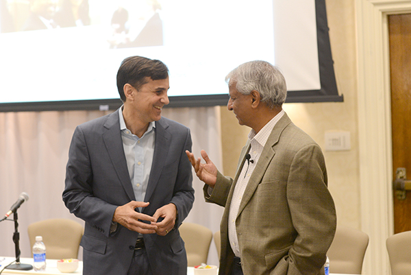 Johns Hopkins President Ronald Daniels chats with symposium co-founder Desh Deshpande.