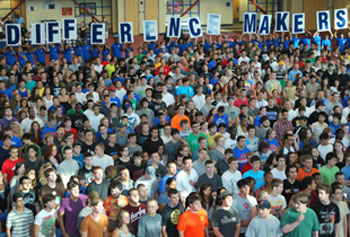 Students involved in the DifferenceMaker program held up signs during Convocation in September.