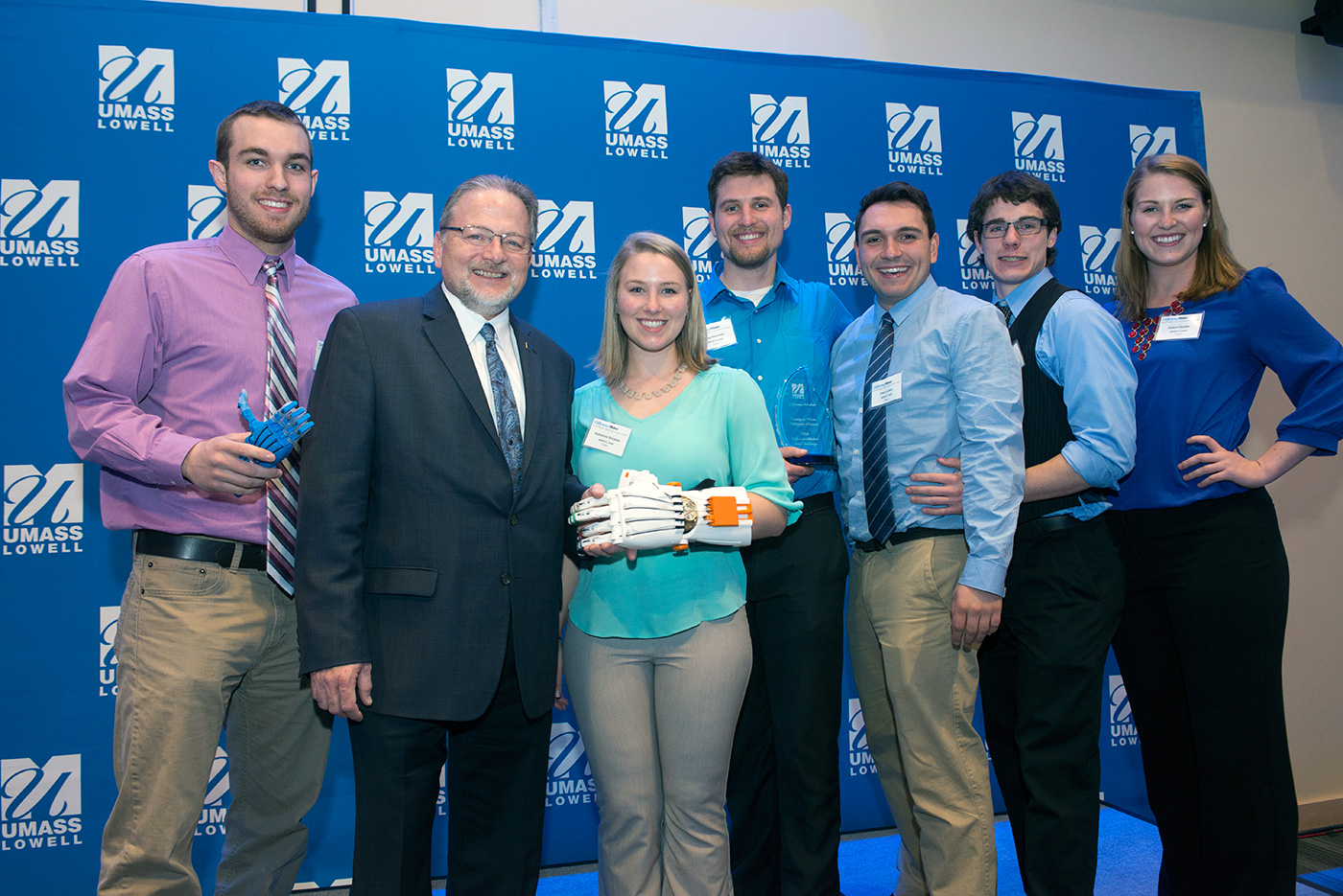 Assoc. Vice Chancellor for Entrepreneurship & Economic Development Steve Tello, second from left, poses with the eNABLE Lowell team after its campuswide DifferenceMaker Idea Challenge win in 2016.