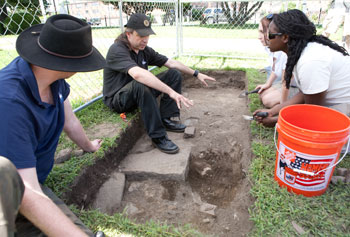 From left, Queen's University graduate student Stuart Alexander; principal surveyor Ronan McHugh of Queen's University Centre for Archaeological Fieldwork; Queen's University student Sarah Kerr; and UMass Lowell graduate student Eunice Delice excavate a trench at St. Patrick's Church in Lowell.