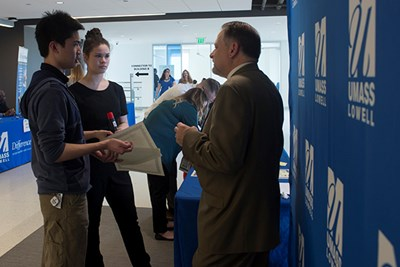 Steven Tello chats with students during a recent DifferenceMaker competition.