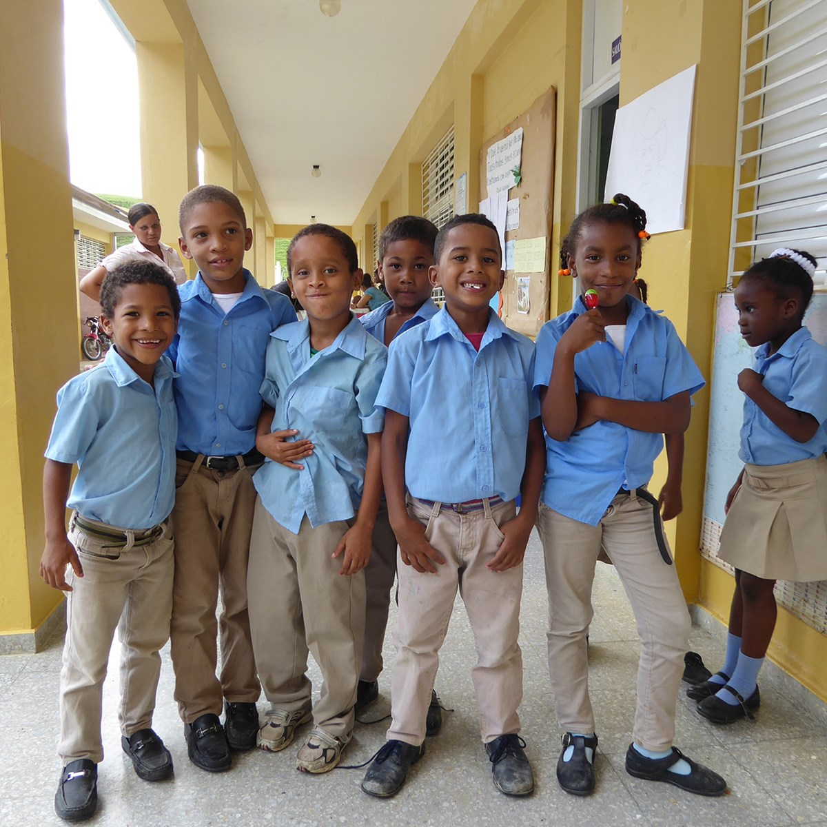 School age children in the Dominican Republish pose for a group photo.