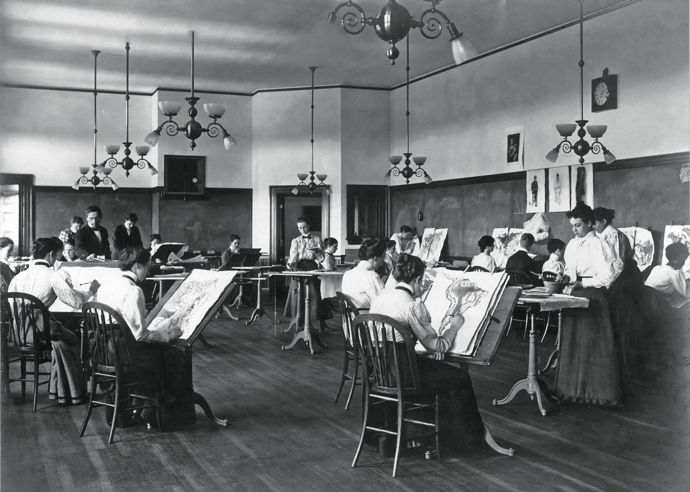Lowell Normal School students used the north light of the large drawing room on the third floor of Coburn Hall to sketch during a drawing class