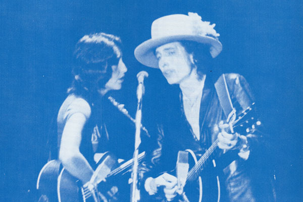 Joan Baez and Bob Dylan serenade the crowd at Costello gym during the Nov. 2, 1975 Rolling Thunder Revue stop at the university.