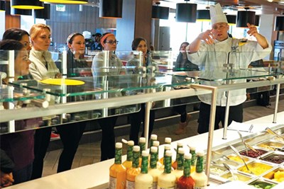 Executive Sous Chef Mike Petit gives students in the Food and Nutrition Management course a tour of the South Campus Dining Commons