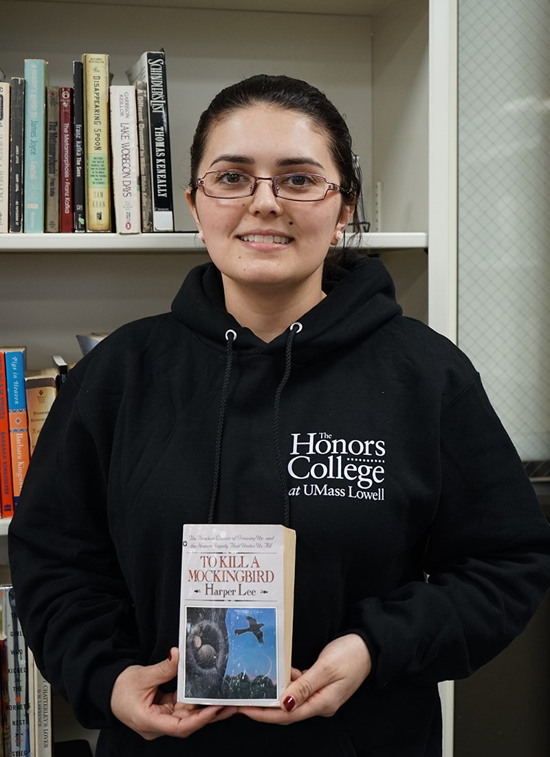 "Edina Hirt holds a copy of ""To Kill a Mockingbird"""