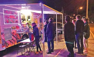 Students line up in the evening to get dinner at the Egyptian Food Truck