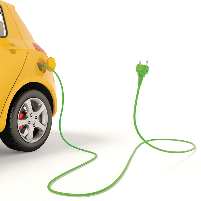 Photo illustration of a yellow electric car with wire and plug
