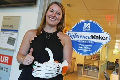 Allison Dunbar '17 (Exercise Physiology); eNABLE Lowell team member poses with prosthetic hand