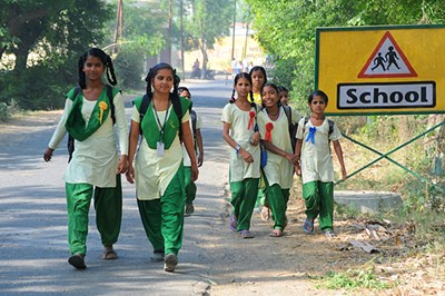 A group walks to Pardada Pardadi, a school for girls in rural India