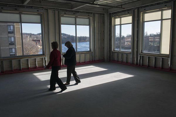 UMass Lowell Chancellor Jacqueline Moloney, left, and vice chancellor Patricia McCafferty walk through the Harbor Place building where UMass announced its plans for the new location of its Haverhill satellite campus, including academic programs and a new initiative that will promote economic development in the city.
