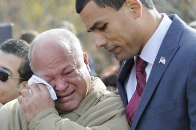 ndy Jiminez, left, father of Alex Jiminez is comforted by former Lawrence veterans agent Francisco Urena.