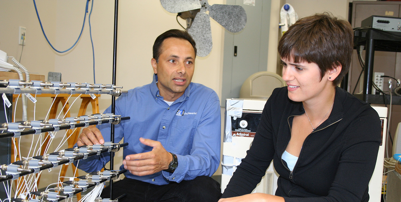 Mechanical Engineering professor Chris-Niezrecki showing equipment to a female student