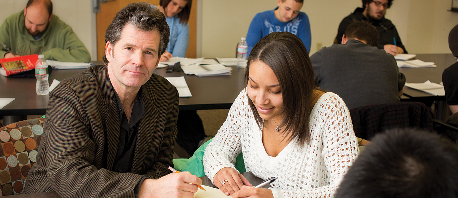 Andre Dubus III poses with a student