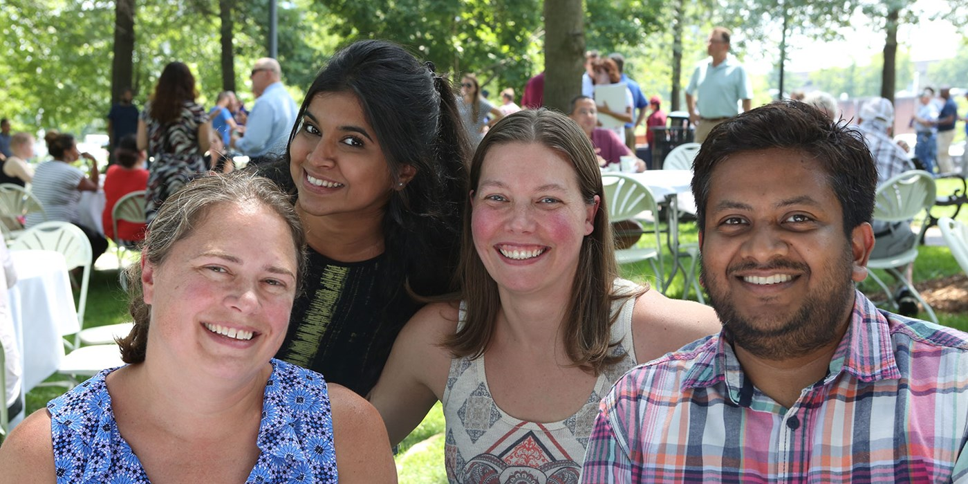 faculty and staff members pose for a photo at the barbecue.