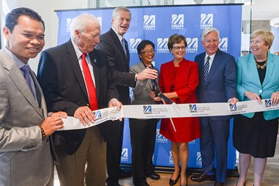 Local dignitaries cut the ribbon to open UMass Lowell's Fabric Discovery Center