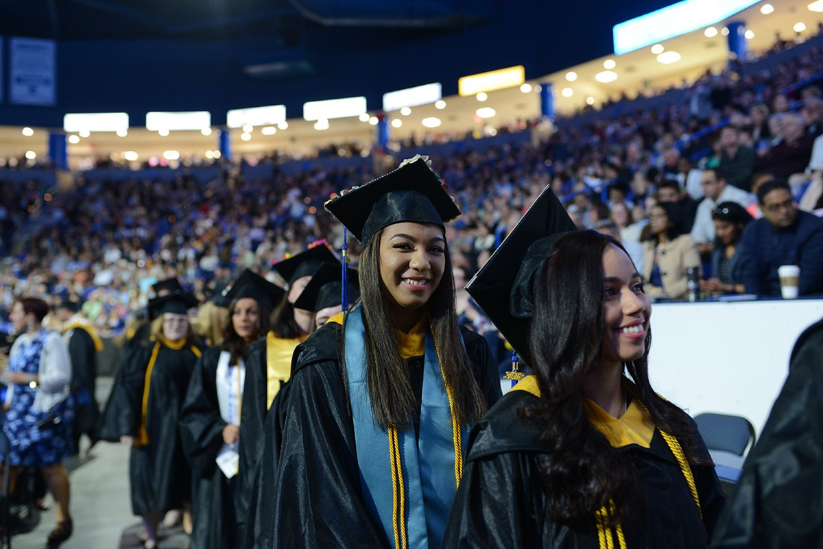 A female graduate smiles during morning Commencement on May 19, 2018.