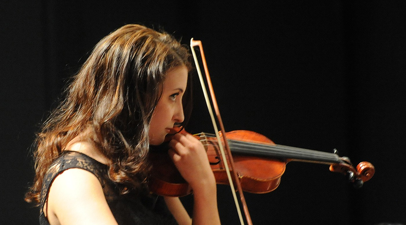 "A violinist performs at the University Orchestra's ""All You Need is Love!"" Valentine's Day concert."