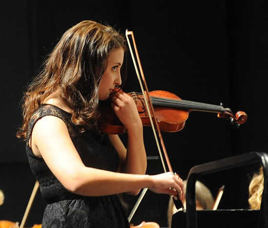 female-student-playing-violin-orchestra