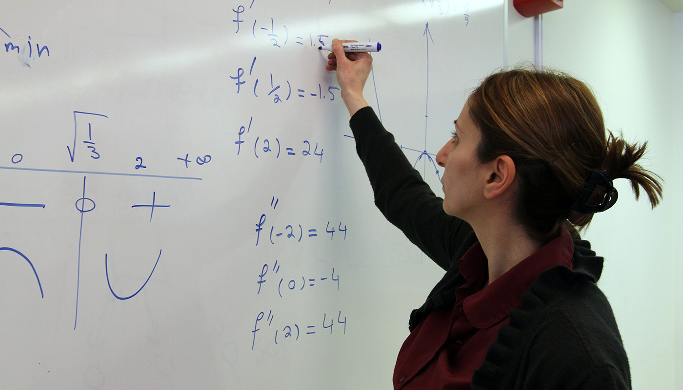 female-writing-equation-whiteboard