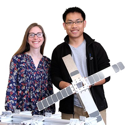 LoCSST Research Scientist Susanna Finn and student Simthyrearch Dy, who holds a scale model of the SPACE HAUC satellite.