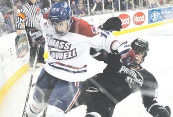 UMass Lowell's David Vallorani and Providence's Alex Velischek get physical in pursuit of the puck last night at Tsongas Center.