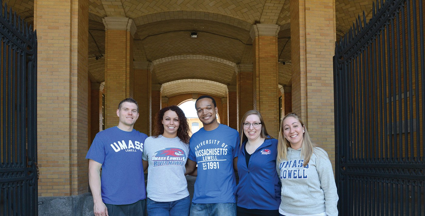 Five students pose for a picture in front of Southwick Hall.