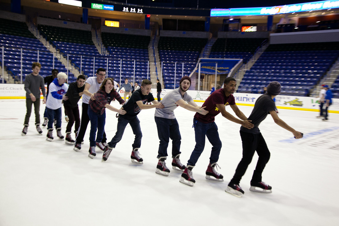 A group of skaters form a chain at the homecoming free skate at the Tsongas Center.