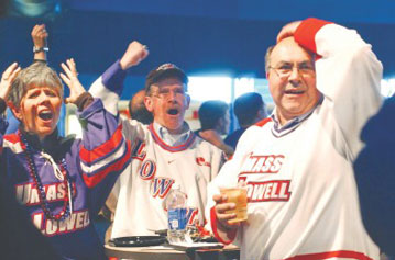 UMass Lowell River Hawks hockey fans watch, in anguish, the Frozen 4 playoff game in Pittsburgh from the Pavillion at the Tsongas Center Thursday afternoon, including, from left, Rhonda Tapply, with husband Jon Tapply of Merrimack, N.H., and Lowell resident John Veiga, at right. UMass Lowell lost a heartbreaker in overtime to Yale, 3-2.