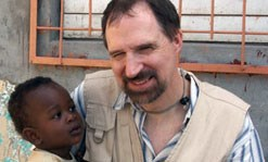 UMass Lowell Professor Robert Giles with young Haitian boy