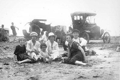 A Portuguese-American family enjoys a day at the beach at a Lowell area lake in the early 1900s.