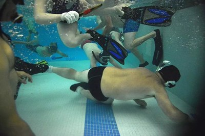 Underwater hockey players