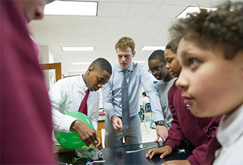 Kyle Weeks, 2013 Stonehill College graduate, is a volunteer teacher at Trinity Catholic Academy in Brockton.