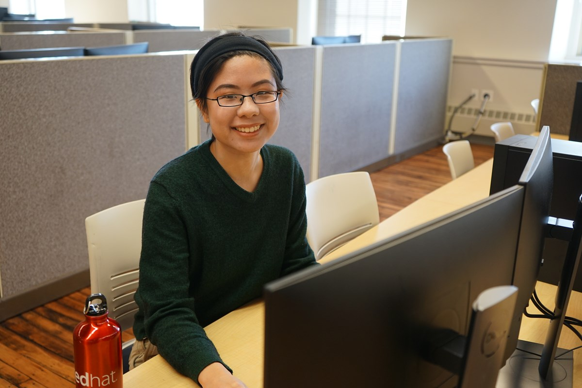 Grace Chin works at a computer on campus