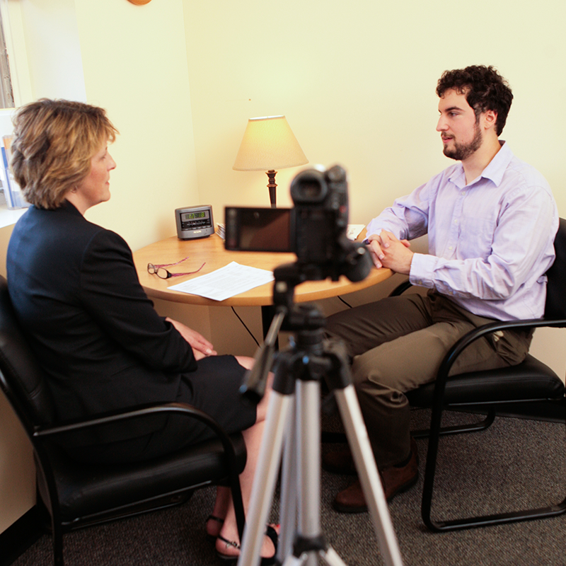 man and woman practicing interviewing skills in front of camera